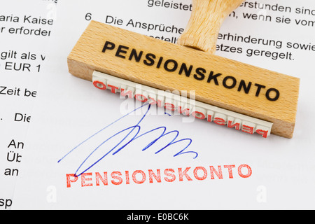 A stamp of wood lies on a document. German label: Pension discount payment, Ein Stempel aus Holz liegt auf einem - Stock Photo