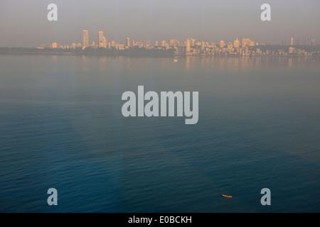 Sea views from Marine Drive to Southern Mumbai,early fisherman in morning twilight, Mumbai,Bombay,India - Stock Photo