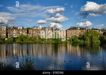 Hampstead No 1 Pond with the houses of South Hill Park, Hampstead Heath, London, UK - Stock Photo