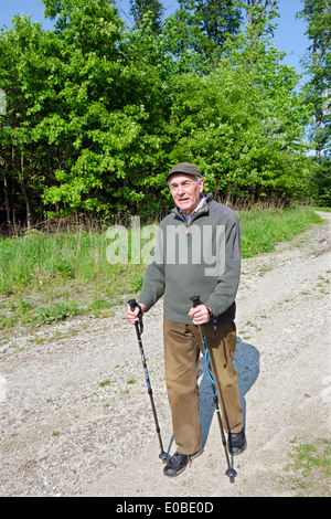 The senior man by nordic walking - Stock Photo