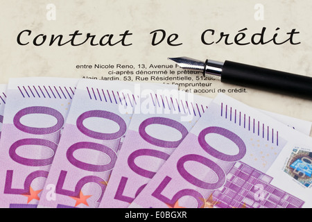 A lot of euro of bank notes and loan contract (In French), Viele Euro Geldscheine und Kredit Vertrag (Franzoesisch) - Stock Photo