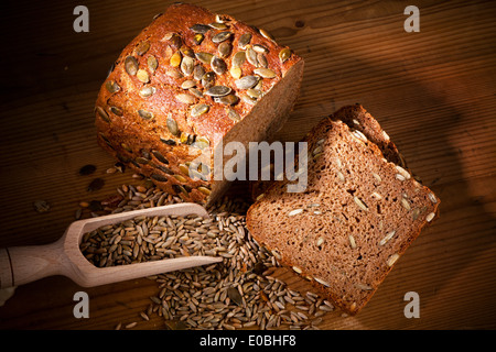 A fresh bread with pumpkin kernels - Stock Photo