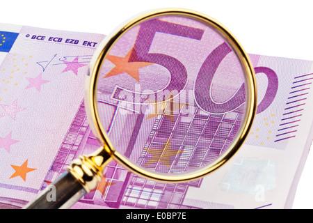 A lot of 500 euromoney bank notes lies on a pile. Seen by a magnifying glass, Viele 500 Eurogeld Banknoten liegen - Stock Photo
