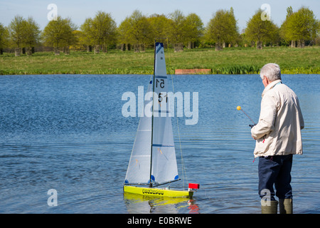 Elderly Man Sailing His Model Yacht On Rick Pond Home Park Kingston Surrey