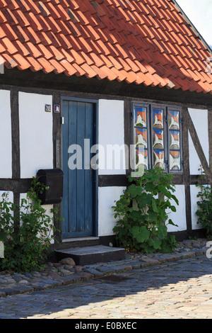 Quaint old timbered single-story residential house front door and window. Ebeltoft, Jutland, Denmark, Scandinavia - Stock Photo