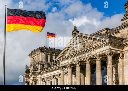 The Reichstag building with German flags, Berlin, Germany - Stock Photo