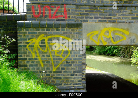 Graffiti on bridge over Grand Union Canal, Aylesbury - Stock Photo