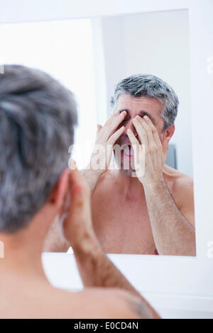 Man with mirror - Stock Photo