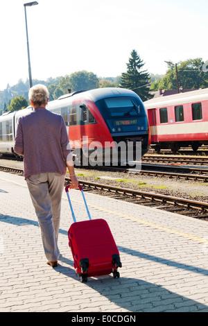 older vital senior citizens in the railway station