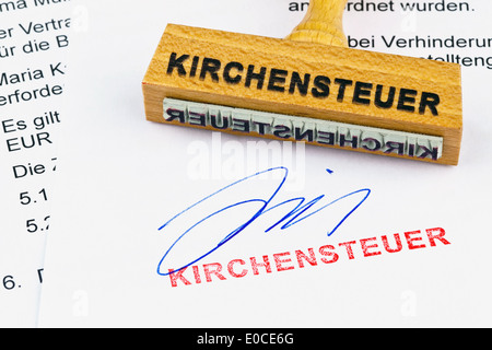 A stamp of wood lies on a document. Label Church-expensive, Ein Stempel aus Holz liegt auf einem Dokument. Aufschrift - Stock Photo
