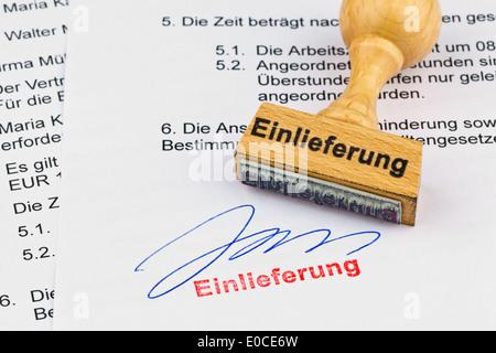 A stamp of wood lies on a document. Label Admission, Ein Stempel aus Holz liegt auf einem Dokument. Aufschrift Einlieferung - Stock Photo