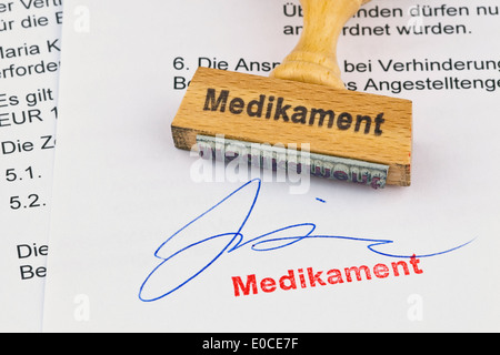 A stamp of wood lies on a document. Label Drug, Ein Stempel aus Holz liegt auf einem Dokument. Aufschrift Medikament - Stock Photo