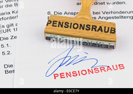 A stamp of wood lies on a document. Label Pension robbery, Ein Stempel aus Holz liegt auf einem Dokument. Aufschrift - Stock Photo