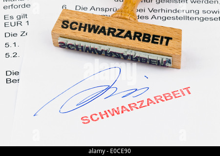 A stamp of wood lies on a document. Label Illegal employment, Ein Stempel aus Holz liegt auf einem Dokument. Aufschrift - Stock Photo