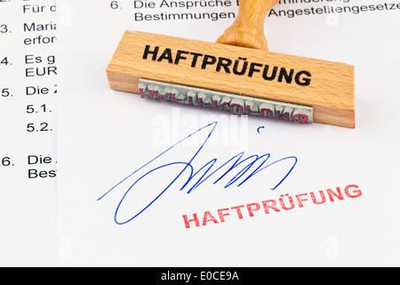A stamp of wood lies on a document. Label Custody check, Ein Stempel aus Holz liegt auf einem Dokument. Aufschrift - Stock Photo