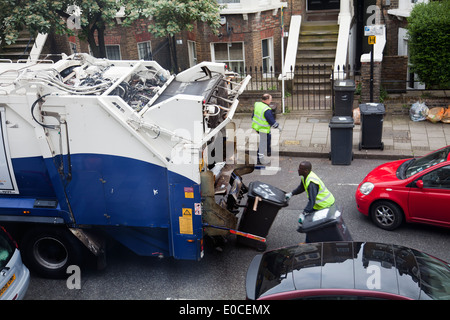 Rubbish Bins Collection on London Residential Street - Clapham - London UK - Stock Photo