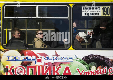 Odessa, Ukraine. 8th May, 2014. Ukraine - Odessa - Daily life - A woman looks out of a bus window, Odessa, Ukraine, - Stock Photo