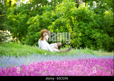 Odessa, Ukraine. 8th May, 2014. Ukraine - Odessa - Daily life - A woman lays on the grass in a public park in Odessa, - Stock Photo