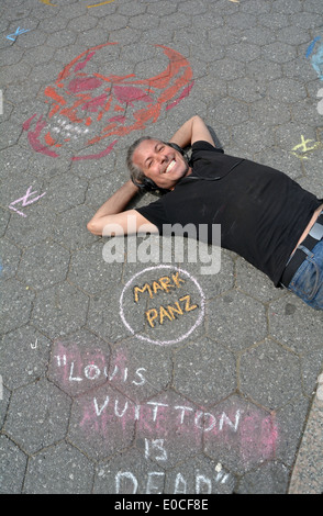 Portrait of street artist MARK PANZ in one of his drawings in Union Square Park, Greenwich Village, New York City. - Stock Photo