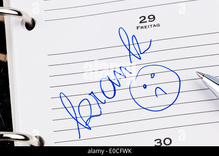 An appointment is put down in a calendar: Ill, Ein Termin ist in einem Kalender eingetragen: Krank - Stock Photo