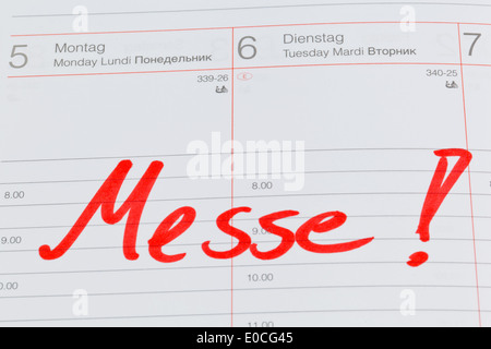 An appointment is put down in a calendar: Fair, Ein Termin ist in einem Kalender eingetragen: Messe - Stock Photo
