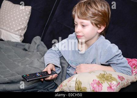 Child watching television - Stock Photo
