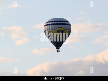 Hot air balloon in flight over a summer landscape in the Northern Netherlands - Stock Photo