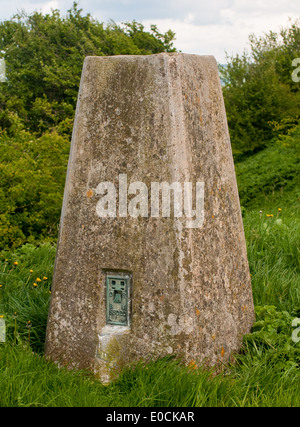 A triangulation station or trig point on a hill top - Stock Photo