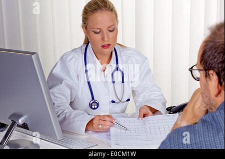 A young doctor with Stethoskop in her medical practise - Stock Photo