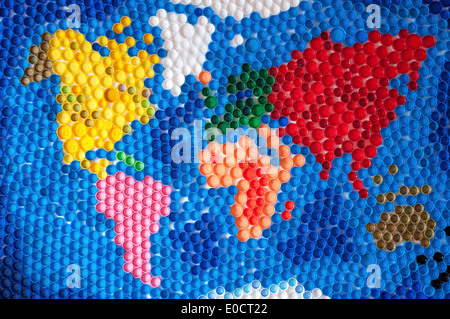 World map made by plastic caps - Stock Photo
