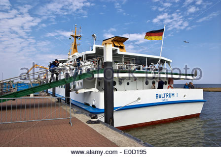 At Neßmersiel, passengers board a ferry bound for Insel Baltrum, one of the East Friesland islands on Germany's - Stock Photo