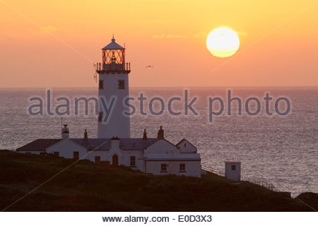 Lighthouse at Fanad Head at sunset; County Donegal, Ireland - Stock Photo