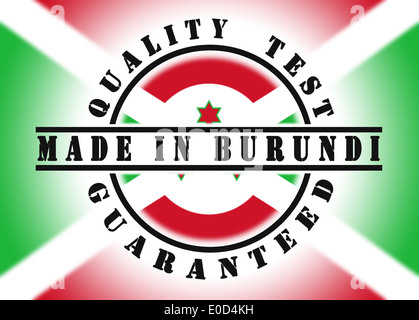 Quality test guaranteed stamp with a national flag inside  Burundi - Stock Photo