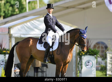 Badminton, UK. 09th May, 2014.  09.05.2014.  Badminton,Overnight leader Clark Montgomery (USA) riding Loughan Glen - Stock Photo