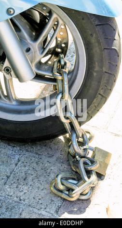 Motorcycle with padlock secure. Protection against theft., Motorrad mit Vorhaengeschloss gesichert. Sicherung gegen - Stock Photo