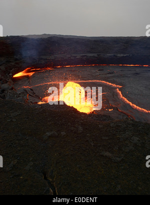 the living lava lake in the crater of Erta Ale volcano in the Danakil Depression, Ethiopia - Stock Photo
