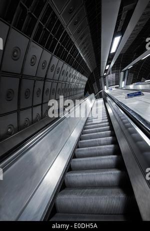 An escalator at Westminster Station on the London Underground, England UK - Stock Photo
