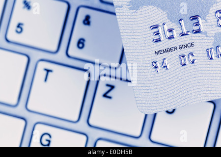 Close-up of a credit card pay for the cashless and keyboard. Symbolic photo for shopping on the Internet., Nahaufnahme - Stock Photo