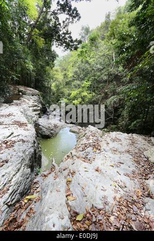beautiful waterfall flows between stones photographed closeup - Stock Photo