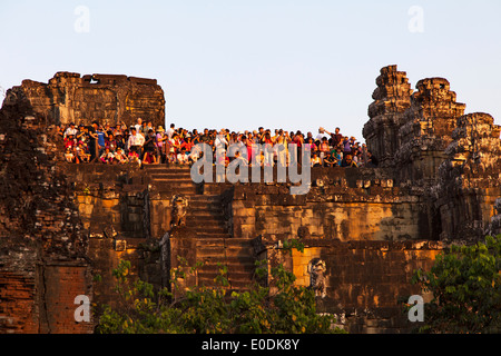 A Large Crowd Watching the Sunset at Phnom Bakheng Temple, Angkor, Cambodia - Stock Photo