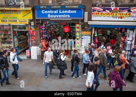 Souvenir shops in London, England, UK Britain full of souvenir hunters as pedestrians walk past. - Stock Photo