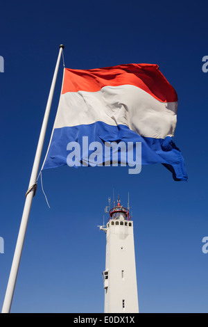 Dutch flag and lighthouse, Noordwijk aan Zee, Noord Holland, Netherlands - Stock Photo