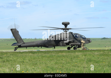 Apache AH1 Longbow helicopter refuels in the field during Exercise Patshun Dawn - Stock Photo