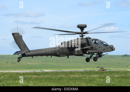 Apache AH1 Longbow helicopter comes in to land in order to refuel in the field during Exercise Patshun Dawn - Stock Photo