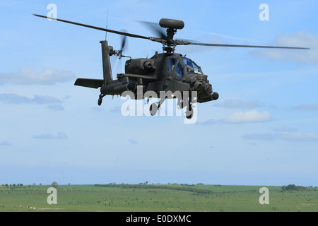 Army Air Corps Apache AH1 on a low level flight across Salisbury Plain Training Area during Exercise Patshun Dawn - Stock Photo
