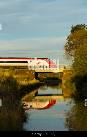 Virgin Trains Pendolino class 390 high speed passenger train in the Tamworth-Lichfield area of the West Coast Mainline - Stock Photo