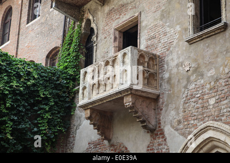 Famous balcony at the Juliet's House, tourist attraction in Verona, Italy - Stock Photo