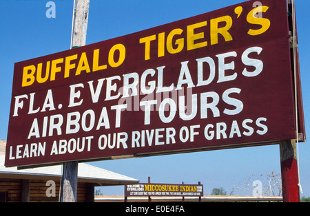 A roadside sign advertises Buffalo Tiger's Florida Everglades Airboat Tours from a departure dock on the Miccosukee - Stock Photo