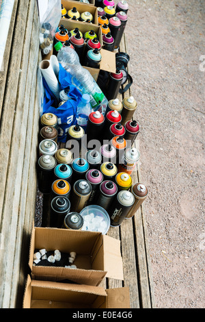 Graffiti spray cans and accessories - Stock Photo