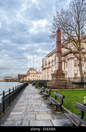 Thames riverside view of Granite Obelisk war memorial and Old Royal Naval College buildings - Greenwich, London, - Stock Photo